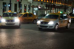 Taxi cars in bucharest Royalty Free Stock Photos