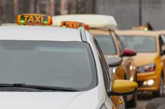 Taxi Cars On The Street Of The City On Day Stock Images