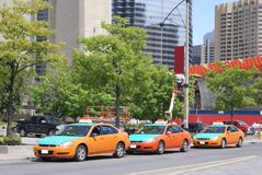 Taxi cars parked. A car lot of taxi cars on parking area. Taxis line up in a car park Stock Photography
