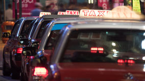 Taxi cars parked in row at night Stock Photography