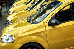 Taxi Cars in a row. Cars in a row car dealership Stock Photo