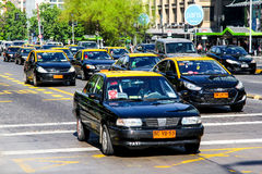 Taxi cars. SANTIAGO, CHILE - NOVEMBER 13, 2015: Black taxi cars at the city street Royalty Free Stock Photo
