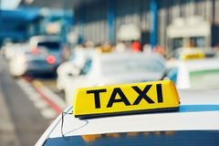 Taxi cars on the street. In against airport terminal. Prague, Czech Republic stock images