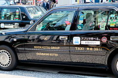 Taxi cars in Tokyo. TOKYO, JAPAN - APRIL5, 2017 :Taxi cars on the street near the ueno station in Tokyo on APRIL5, 2017 in Tokyo, Several taxi cabs are waiting Stock Image