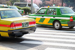 Taxi cars in tokyo. TOKYO, JAPAN - APRIL5, 2017 :Taxi cars on the street near the ueno station in Tokyo on APRIL5, 2017 in Tokyo, Several taxi cabs are waiting Royalty Free Stock Photo