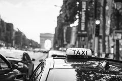 Taxi at the champs elysees Royalty Free Stock Photography