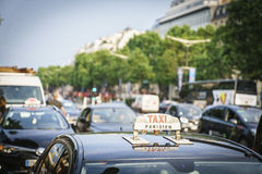 Taxi at the champs elysees Stock Images