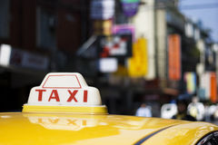Taxi in the city Stock Images