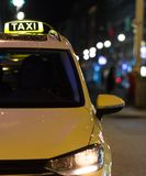 Taxi in a city at night. A taxi in a city at night Royalty Free Stock Photos