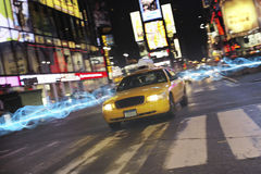 Taxi on city street at night Royalty Free Stock Images