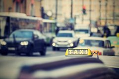 Taxi on city streets with a digital retro effect Royalty Free Stock Photo