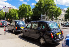 Taxi on Cromwell Gardens street, South Kensington, London, United Kingdom Royalty Free Stock Image