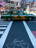 Taxi and crowd in crossing Royalty Free Stock Images