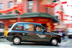 Taxi de Londres dans Chinatown Photos stock