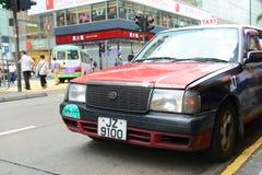 Taxi del rojo de Hong Kong Urban Fotografía de archivo libre de regalías