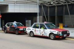 Taxi del rojo de Hong Kong Urban Foto de archivo