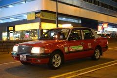 Taxi del rojo de Hong Kong Urban Imagen de archivo libre de regalías