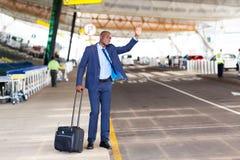 Taxi dell'aeroporto dell'uomo d'affari Immagini Stock