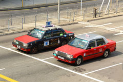 Taxi di rosso di Hong Kong Urban Immagine Stock Libera da Diritti