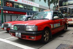 Taxi di rosso di Hong Kong Urban Immagini Stock