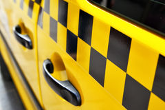 Taxi. Door of taxi with checker Royalty Free Stock Images
