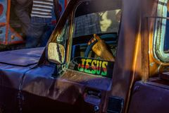 Taxi driver believes in miracles stock photo