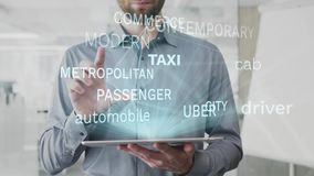 Taxi, driver, cab, automobile, city word cloud made as hologram used on tablet by bearded man, also used animated stock footage