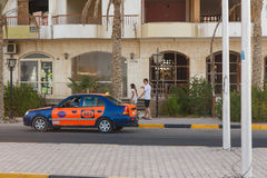 Taxi driver obsession offers its service. HURGHADA, EGYPT - MAY 20: Taxi driver obsession offers its service to a pair of European tourists. Hurghada, Egypt. May stock photo