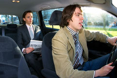 Taxi driver and passenger. A businessman in the backseat of a taxi Royalty Free Stock Photography