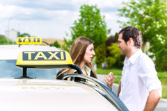 Taxi driver and passenger in front of car Stock Photo