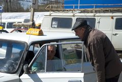Taxi driver and passenger Stock Photo