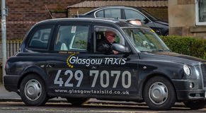 A taxi driver waiting for customers in Glasgow, Scotland Royalty Free Stock Photos