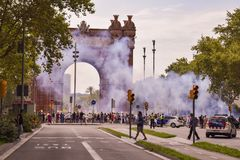 Barcelona, Spain - July 25, 2018: Taxidrivers demonstrate against injustice with posters, flags and smoke bomb. Taxi drivers protest against too many licenses royalty free stock images