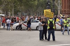 Barcelona, Spain - July 25, 2018: Taxidrivers demonstrate against injustice with posters, flags and smoke bomb. Taxi drivers protest against too many licenses royalty free stock photography