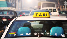 Urban Scene People Traveling in Taxi Car. Heavy traffic in the streets of Egypt capital Cairo. Taxi with yellow roof sign on the car driving during the rush hour royalty free stock image