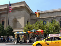 Taxi Drives 5th Avenue Past Food Vendors at the Metropolitan Museum of Art, the Met, Manhattan, NYC, NY, USA royalty free stock photos