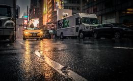 Taxi driving through wet streets in New York Royalty Free Stock Image