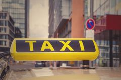 Taxi in Dusseldorf City, Germany. Sign closeup toned Stock Photography
