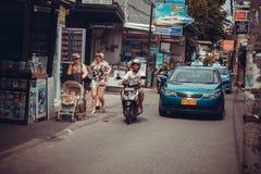 Taxi en fietsers Kuta Royalty-vrije Stock Afbeelding