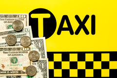Taxi fare concept. Money on the black and yellow background Stock Photos