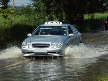 Taxi in flood Royalty Free Stock Photo