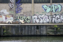 Taxi in front of Brightly painted graffiti wall Royalty Free Stock Photo