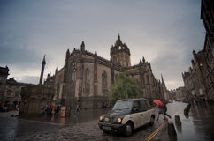 Taxi in front of the Edinburgh museum. Royalty Free Stock Image
