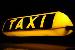 Taxi. German Taxi sign at at night-time Stock Photography