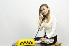 Taxi - girl dispatcher and other materials on the topic of taxi. Taxi industry - dispatcher work reception of orders waiting for the car, telephone conversations royalty free stock images