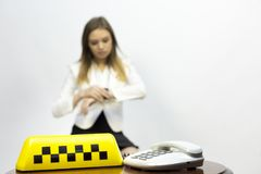 Taxi - girl dispatcher and other materials on the topic of taxi. Taxi industry - dispatcher work reception of orders waiting for the car, telephone conversations royalty free stock photos