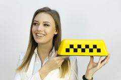 Taxi - girl dispatcher and other materials on the topic of taxi. Taxi industry - dispatcher work reception of orders waiting for the car, telephone conversations stock images
