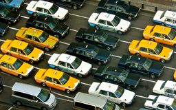 Taxi. Japan taxi gridlock viewed from above. Traditional Japanese cabs. Urban traffic jam of taxi cabs. Metaphor for busy city life, rat race and commuting Royalty Free Stock Photo