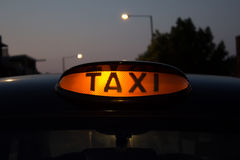 Taxi for hire sign Royalty Free Stock Images