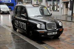 Taxi i stadens centrum Glasgow Arkivfoto